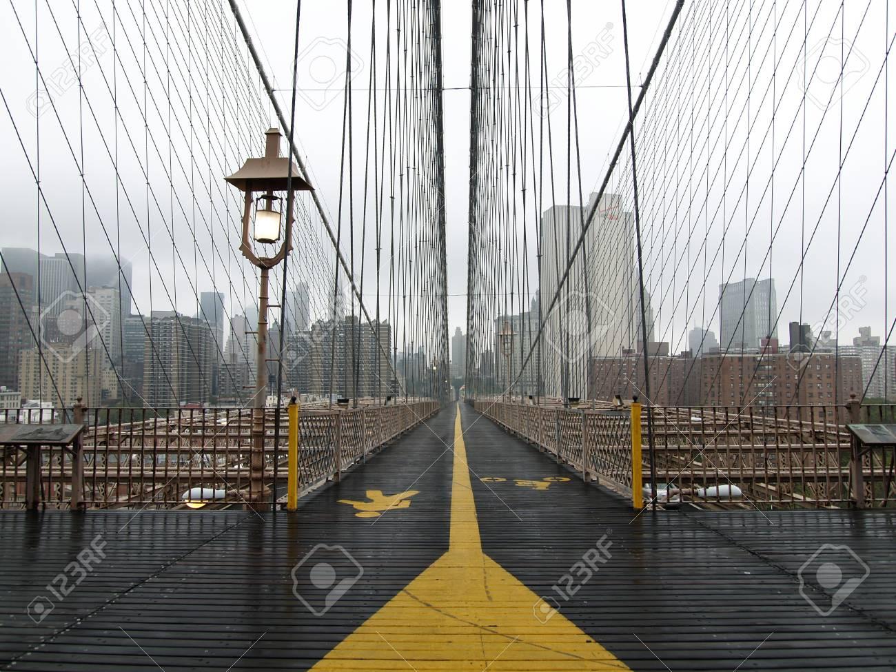 Brooklyn bridge walkway on a quiet foggy morning. Stock Photo - 4560247