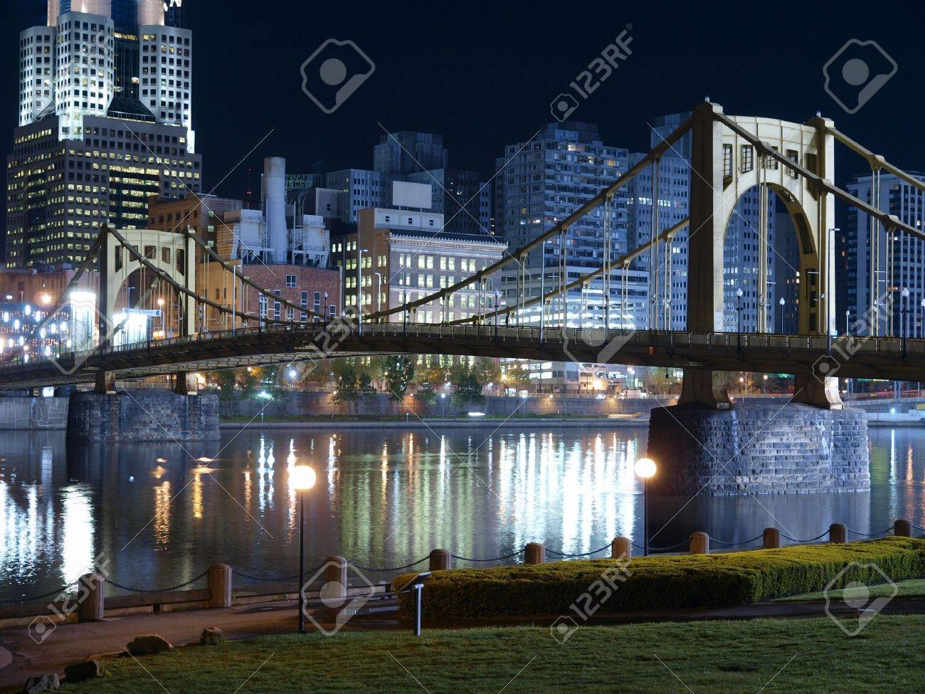 Riverfront park with graceful bridge in Pittsburgh Pennsylvania. Stock Photo - 5275208