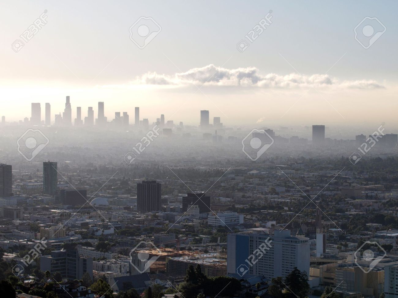 Misty Hollywood sunrise with Downtown Los Angeles in the background. Stock Photo - 5750453