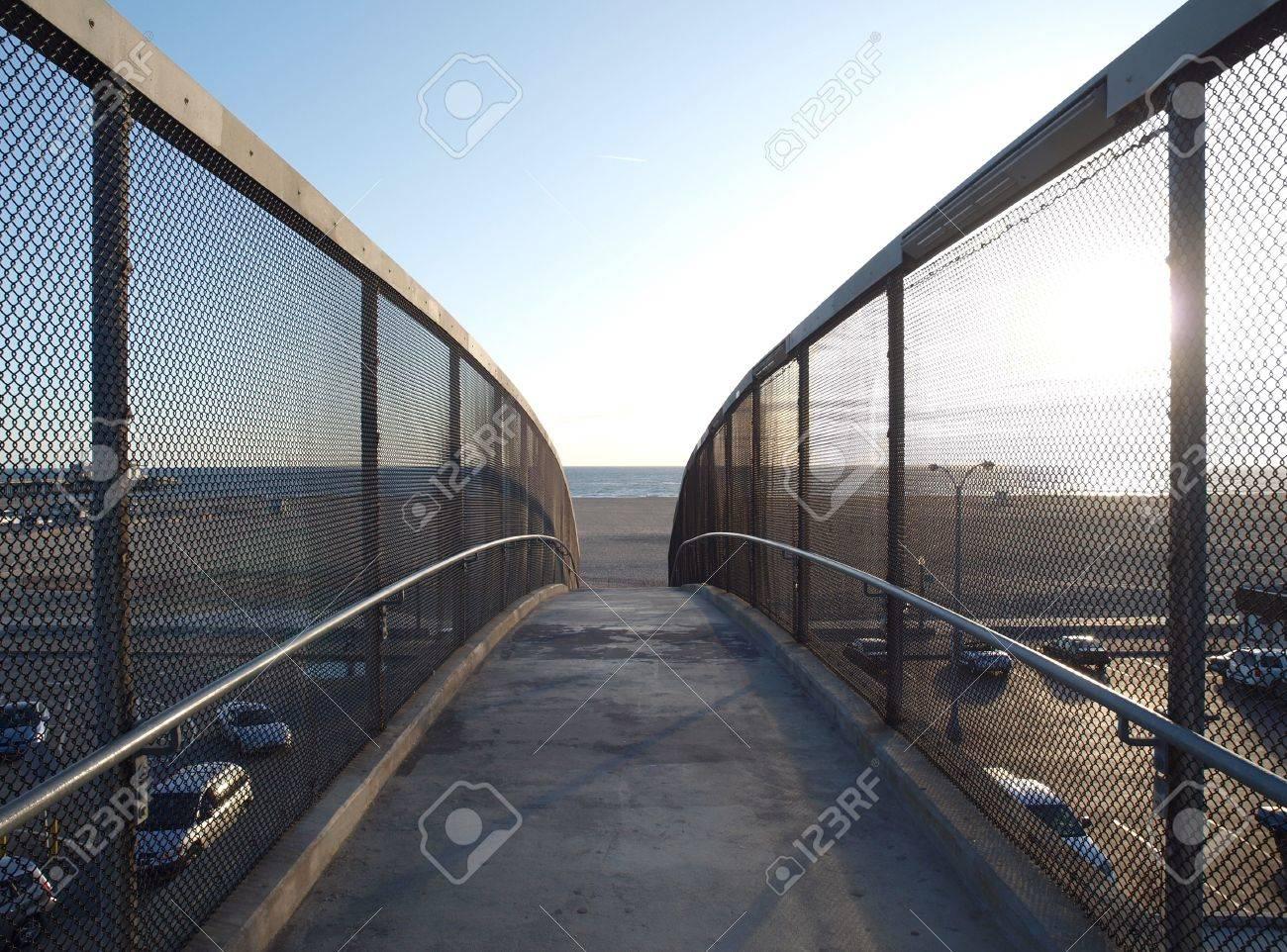 Fun and sun lie ahead.  Pedestrian ramp towards famous Santa Monica Beach at sunset. Stock Photo - 6801844