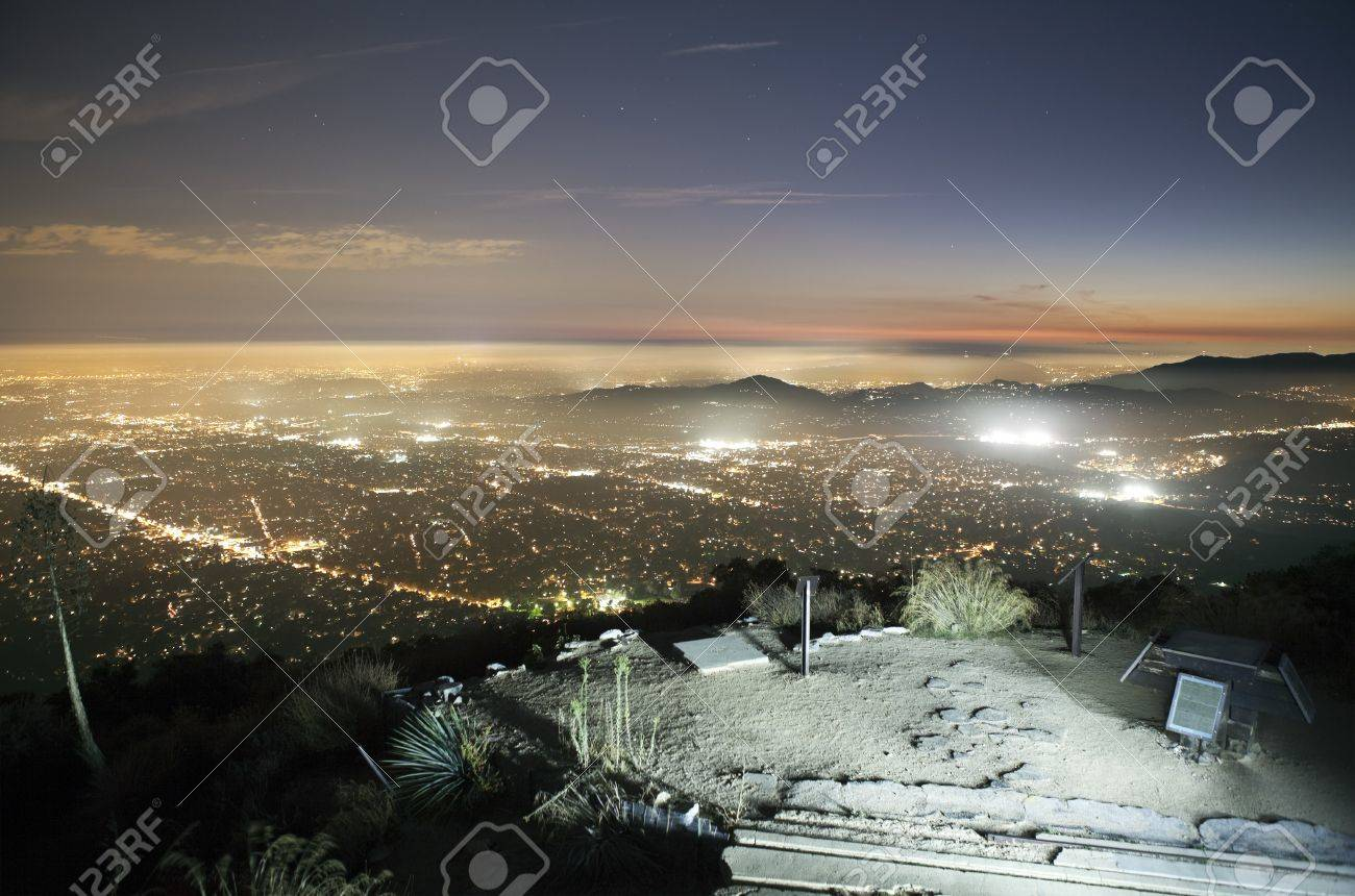 Fog rolls in as bicycle lights illuminate the historic incline railroad landing ruin on top of Echo Mountain above Pasadena and Los Angeles California. Stock Photo - 8127489
