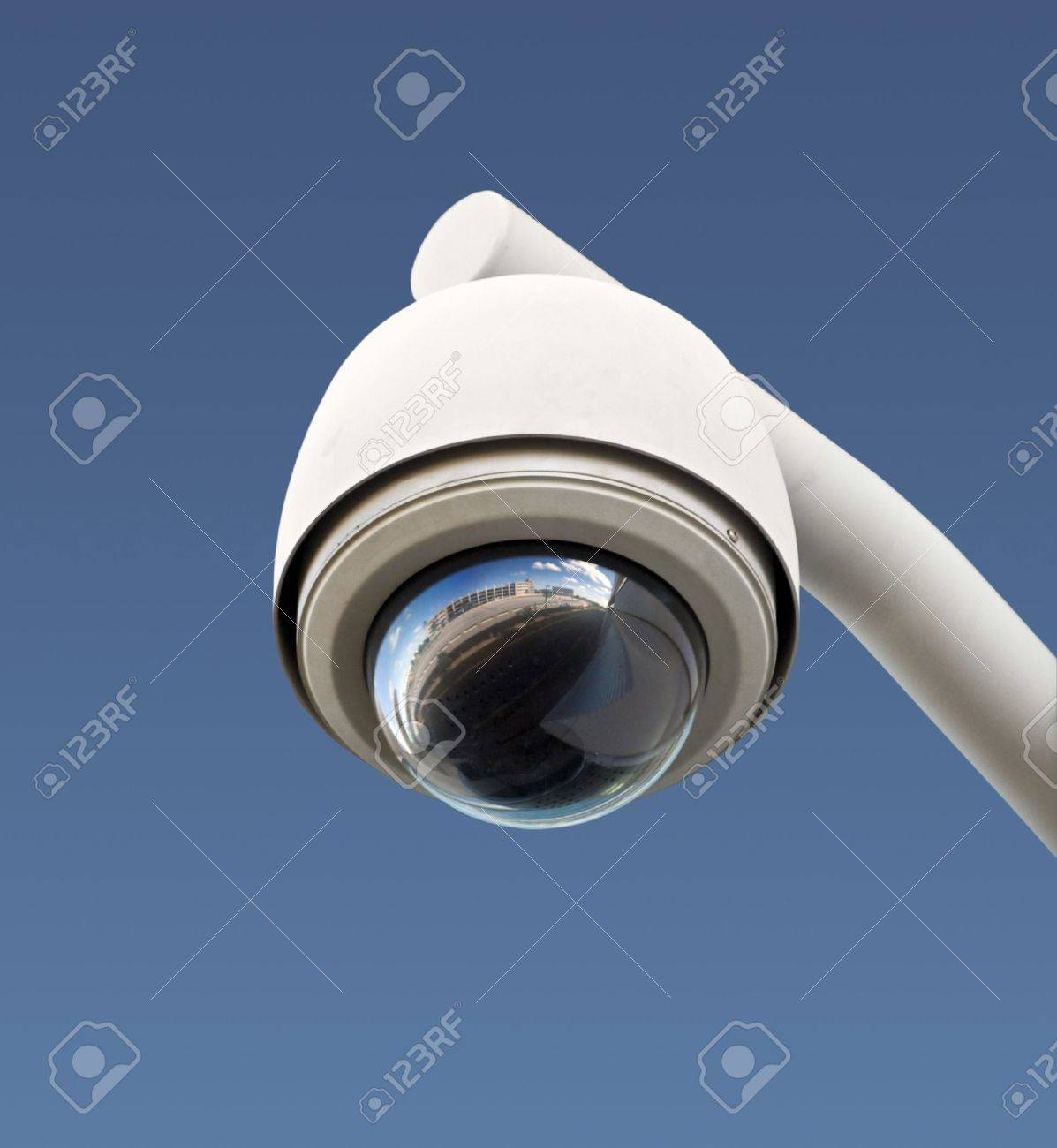 High tech overhead security camera with a gradient blue sky. Stock Photo - 8566543