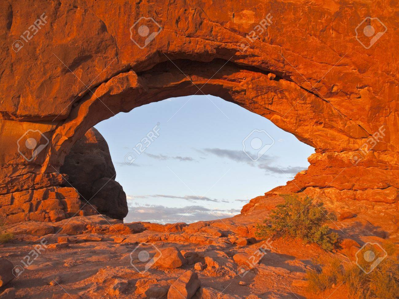 Warm sunset light on North Window Arch at Arches National Park Stock Photo - 14221911