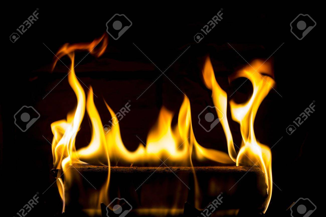 Burning log with black background Stock Photo - 16917244