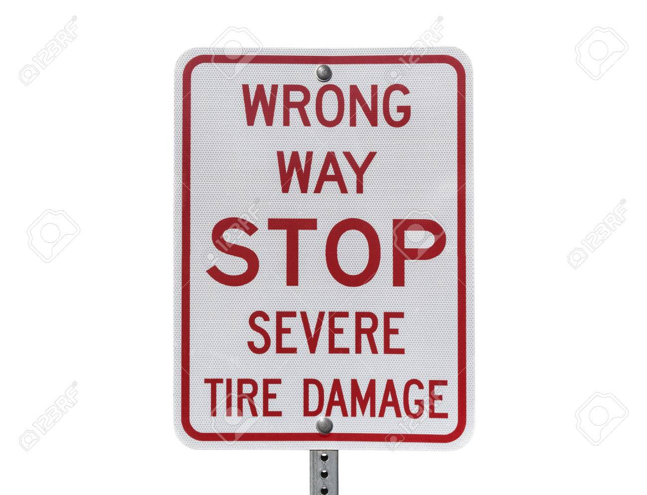 Wrong way stop severe tire damage sign Stock Photo - 23214667