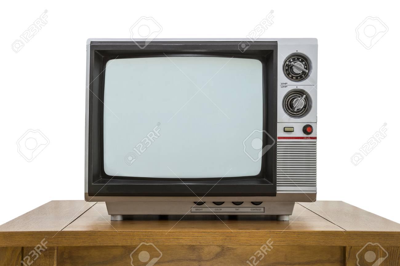 Uitstekende draagbare televisie en oude houten tafel op wit wordt