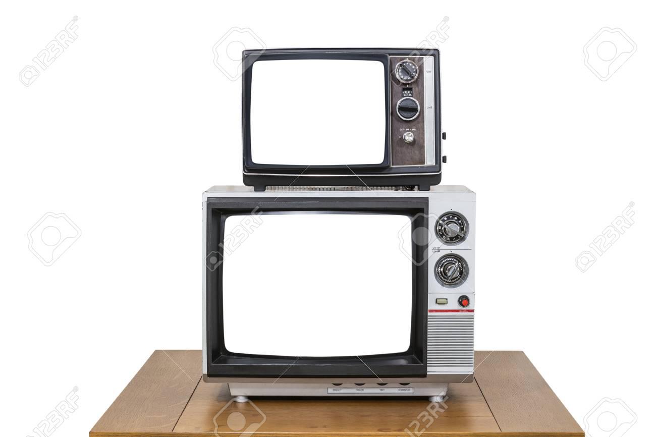 Vintage televisie stack op oude houten tafel geïsoleerd op wit met