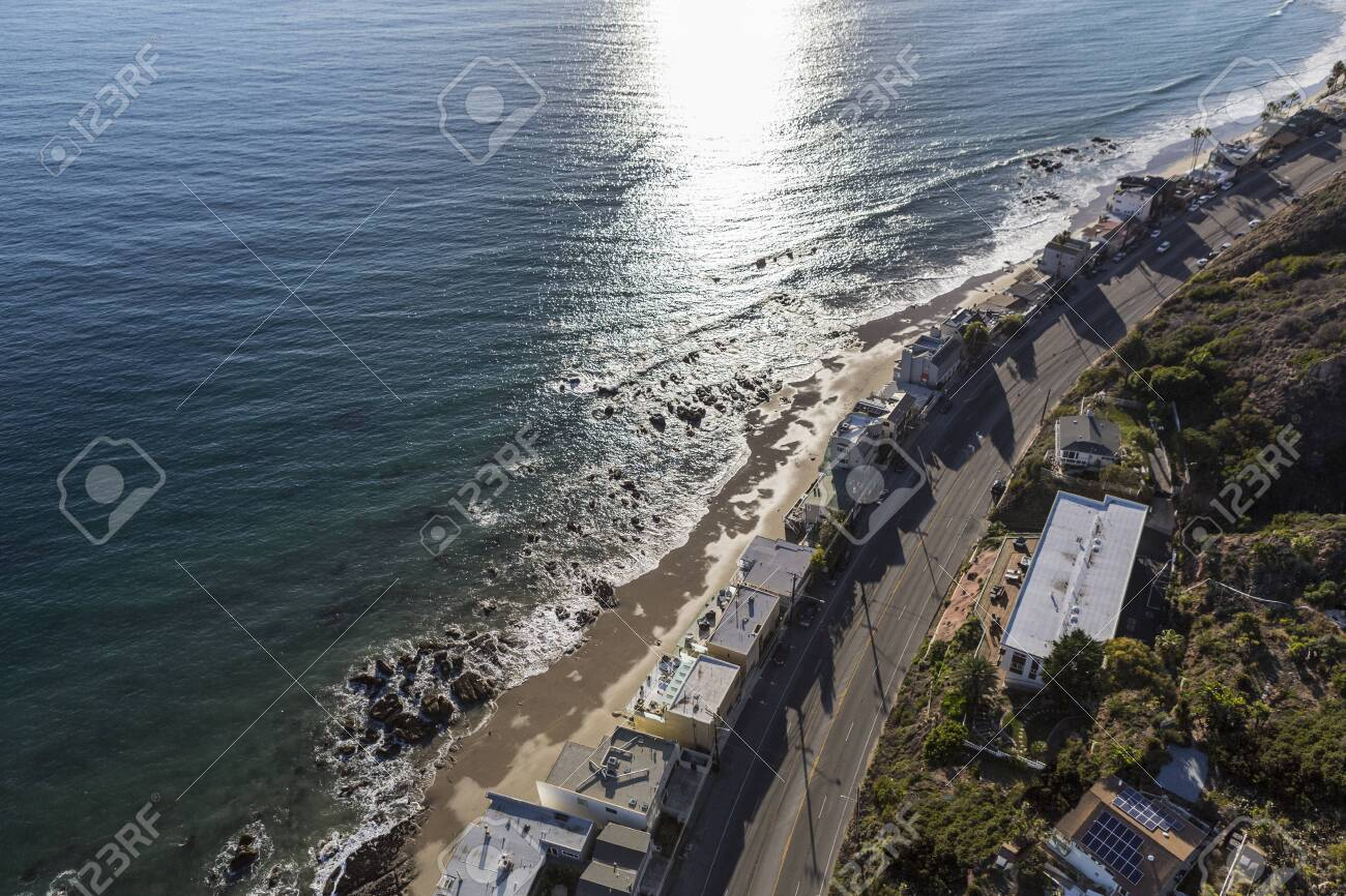 Afternoon Aerial View Of Beach Homes And Pacific Coast Highway
