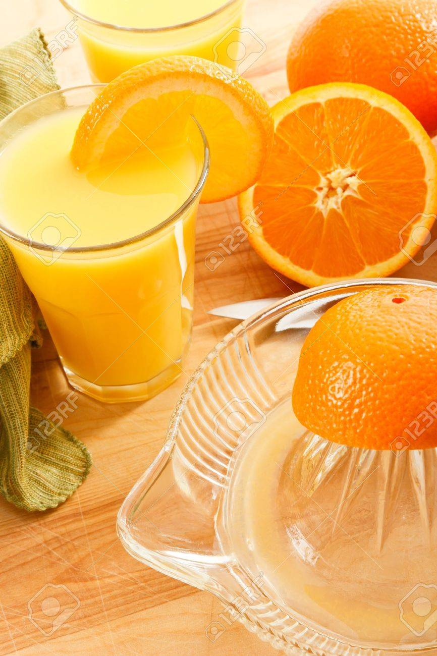 Delicious fresh squeezed orange juice is filled with Vitamin C and Potassium making it a good healthy choice for a natural beverage with breakfast. Stock Photo - 9081346