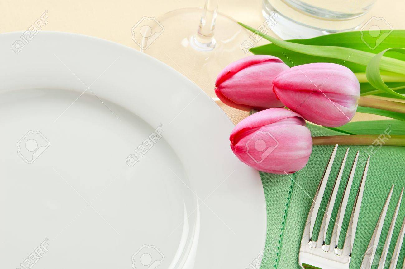 Table Setting Background three pink tulips grace a table setting in fresh spring colors