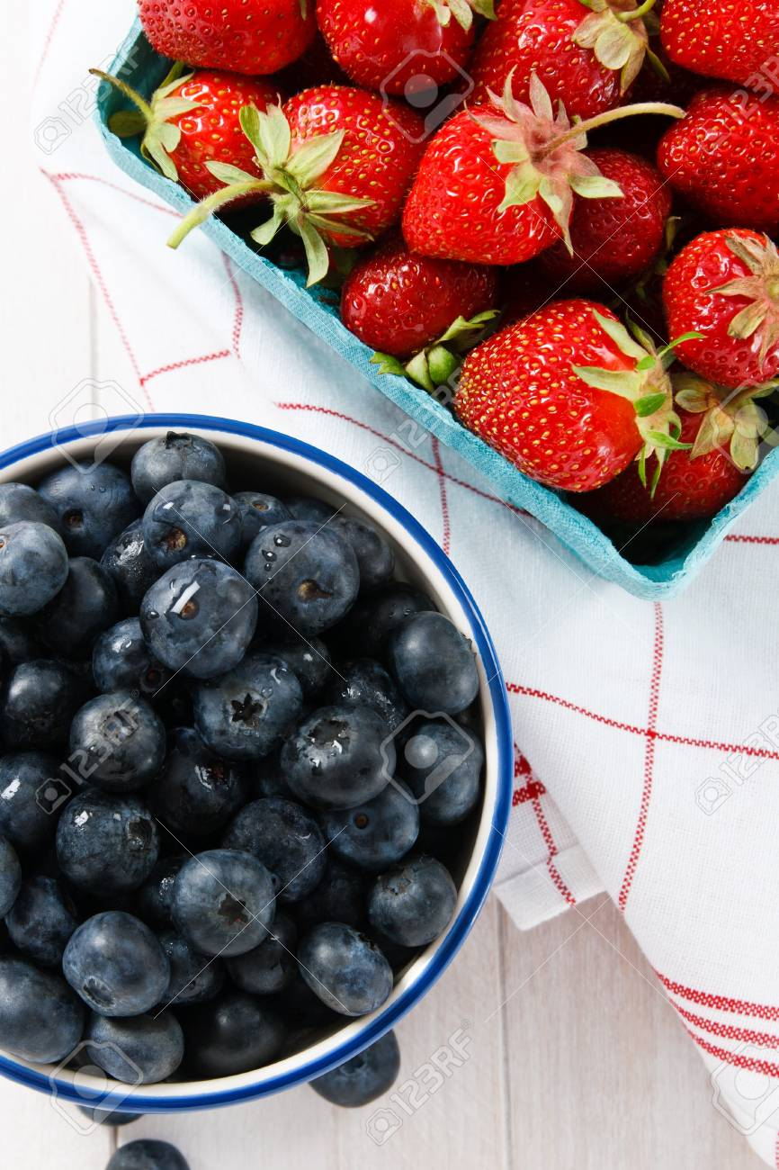 Overhead view of ripe summer strawberries and blueberries Stock Photo - 9825275