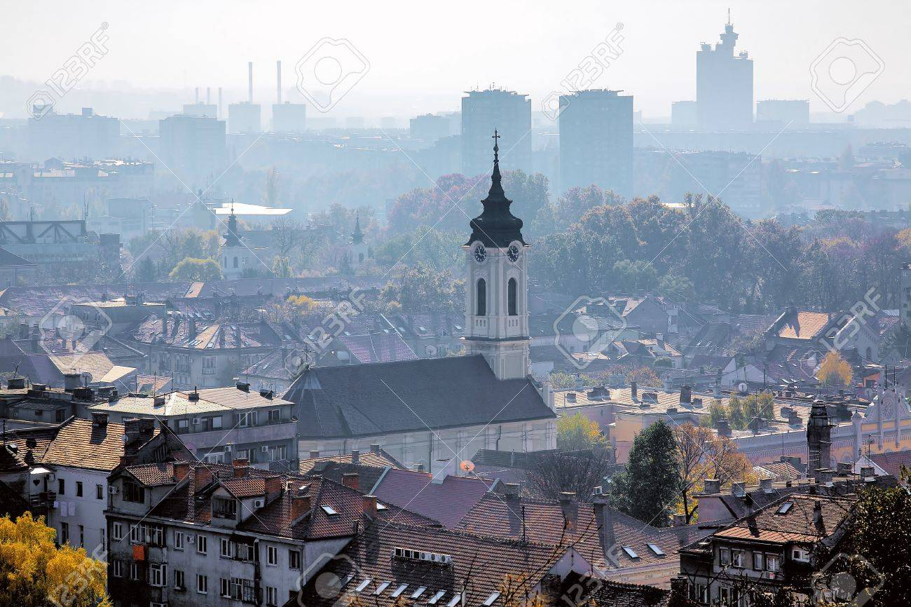 View of the Mother of God Nativity Church in Zemun and Belgrade in the haze, Serbia - 11154159