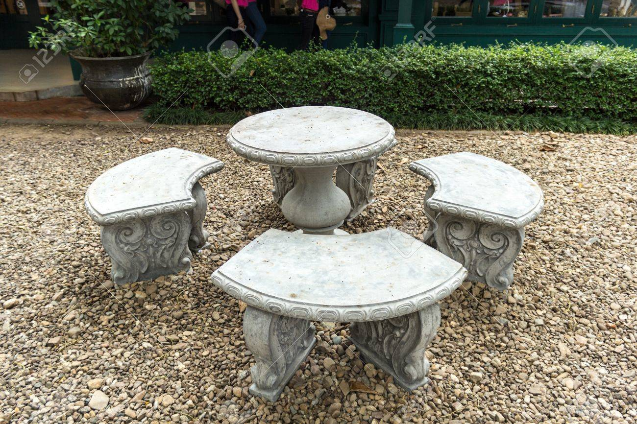 Stone Garden Table and four chairs