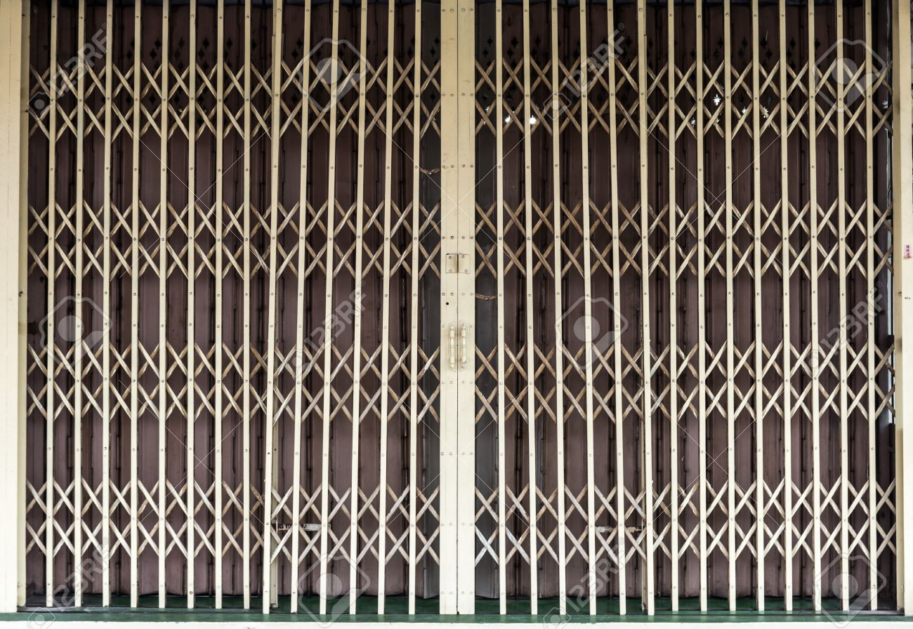 Metal grille sliding door against a metal folding door for metal grille sliding door against a metal folding door for textural background stock photo vtopaller Gallery
