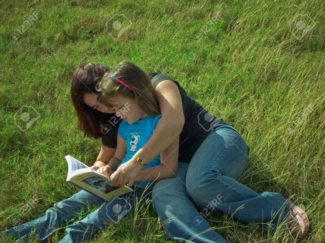 Mother and daughter reading on the grass Stock Photo - 2340193