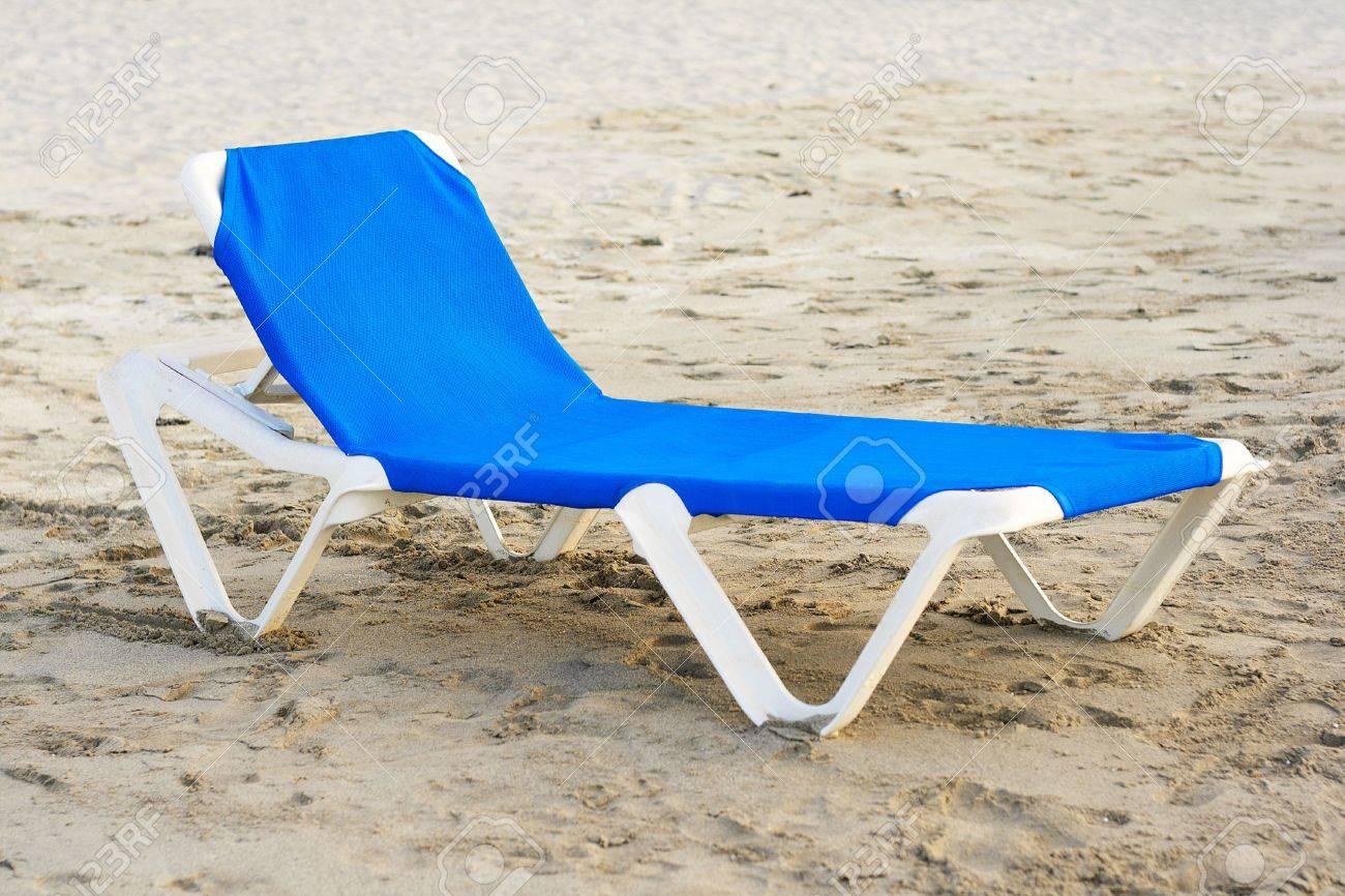 Plastic beach chair - Blue Plastic Beach Chair In A Deserted Beach Stock Photo 5559556