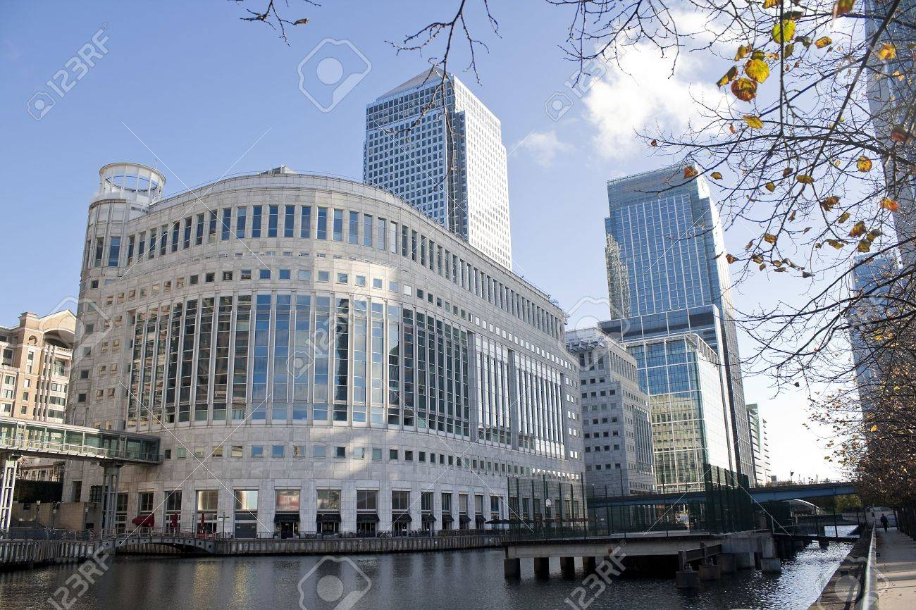 Canary Wharf skyscrapers in London with reflections in the river Stock Photo - 5784610