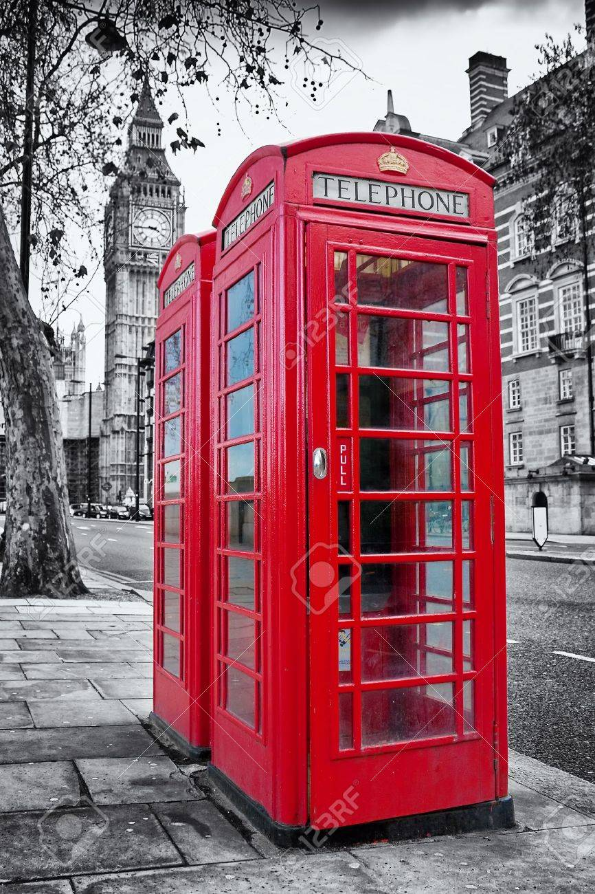A pair of traditional red phone booths in London with the Big Ben in a desaturated background Stock Photo - 10453265