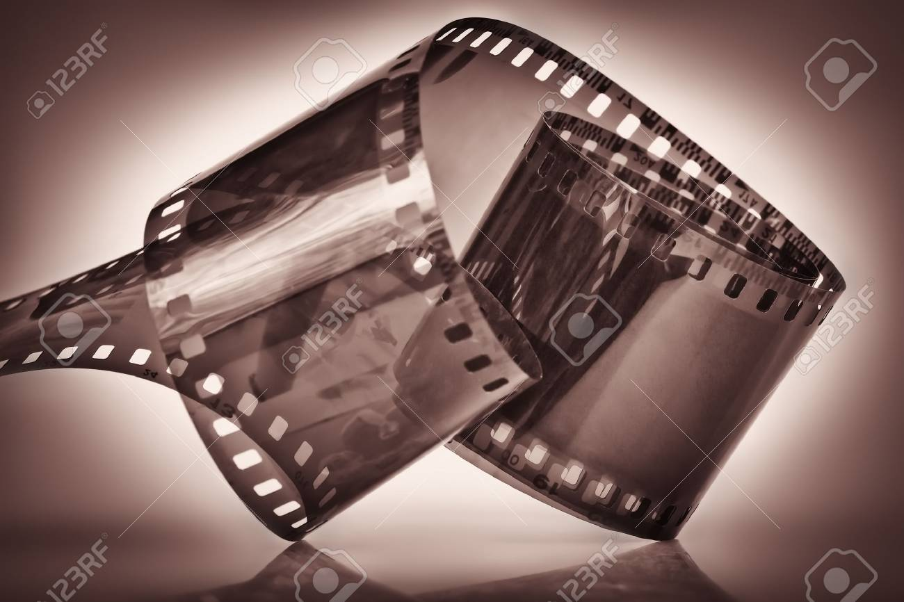 35 mm film on a dramatically illuminated dark depia background Stock Photo - 9397266