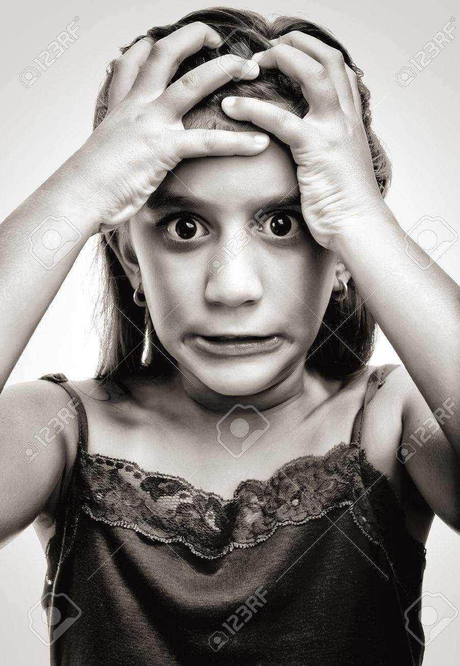 10442662-Dramatic-image-of-a-latin-girl-with-an-angry-and-desperate-face-Stock-Photo.jpg