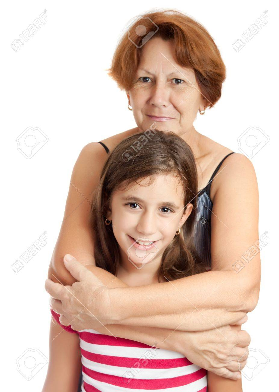 Latin grandmother hugging her granddaughter isolated on a white background Stock Photo - 10442654