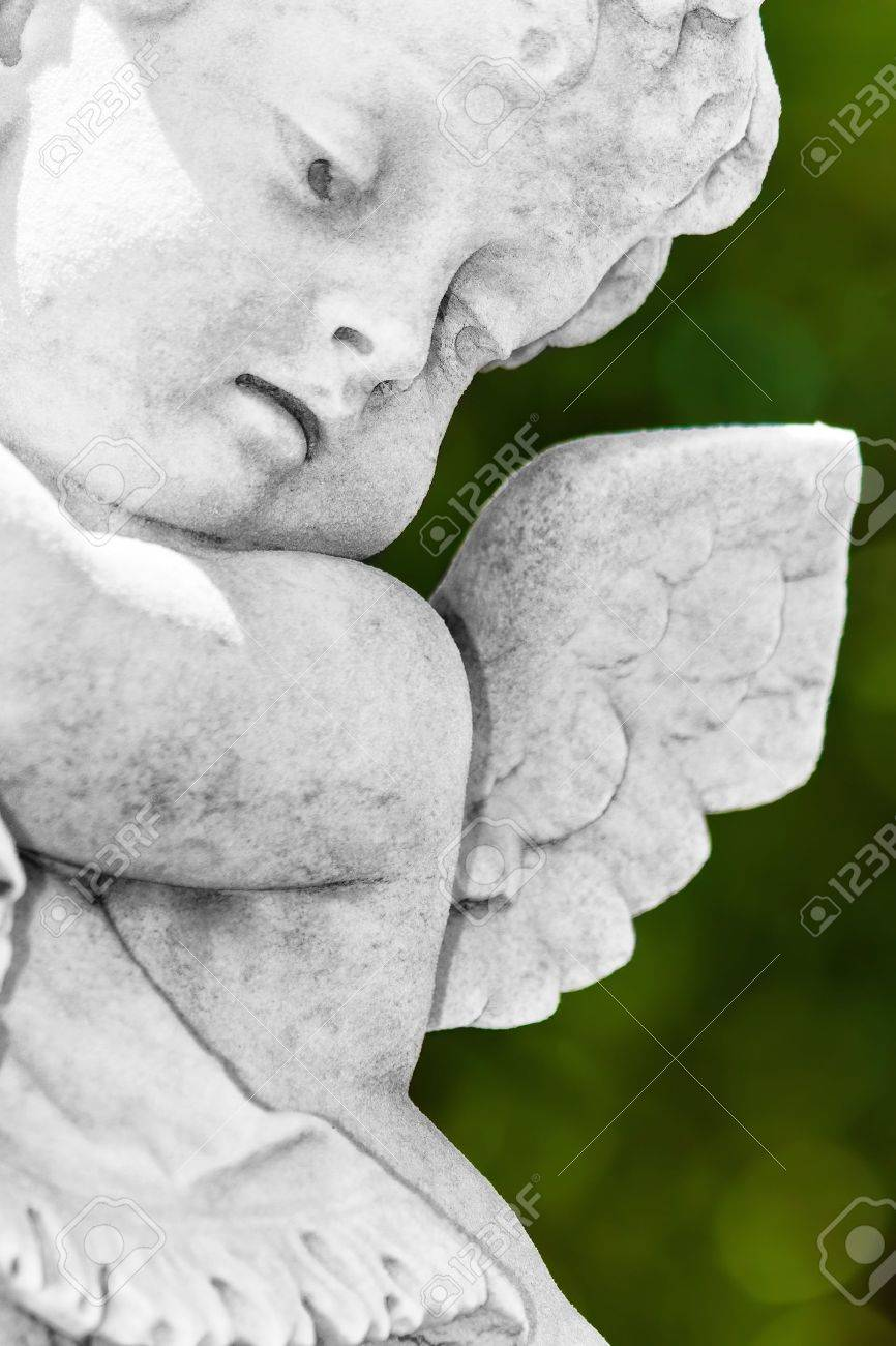 Infant angel with a diffused green vegetation background Stock Photo - 10453271