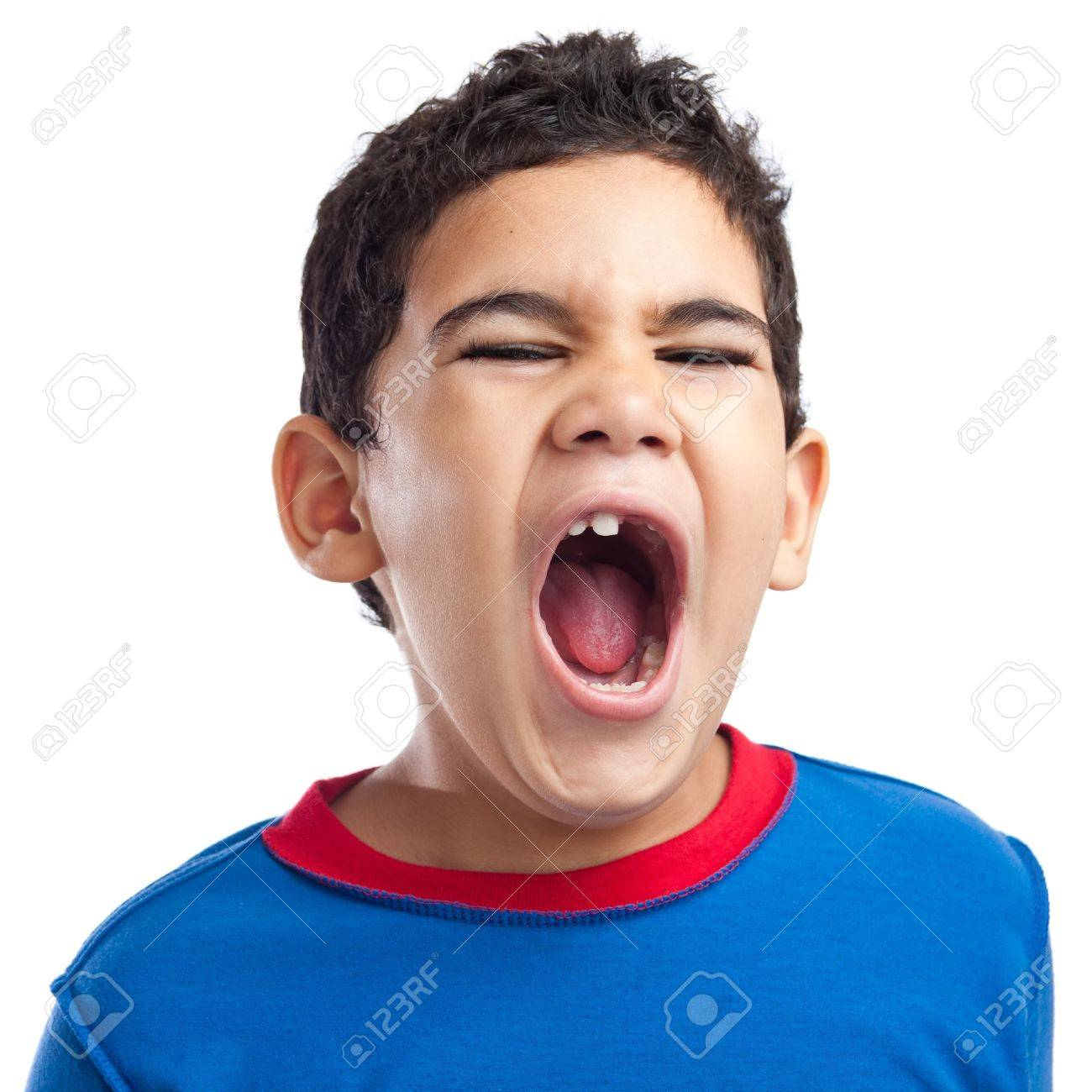 latin boy screaming with anger on a white background stock photo