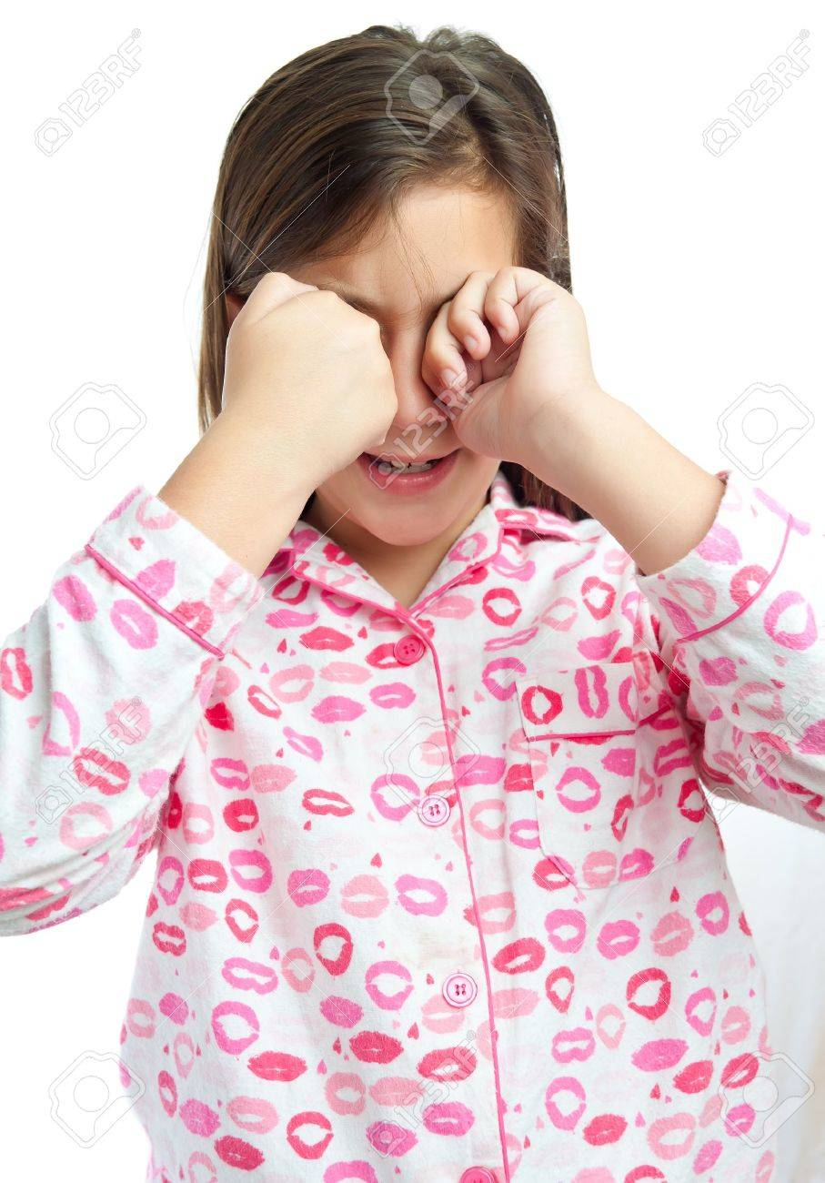 Sleepy Young Girl Wearing Pajamas Isolated On A White Background ...
