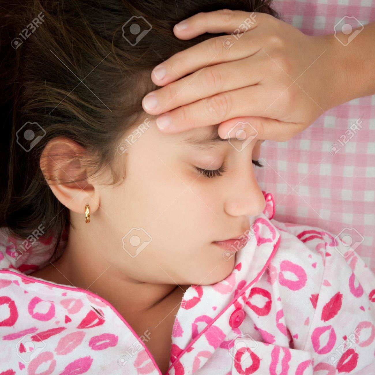 Small girl sick with fever and a woman Stock Photo - 12450849