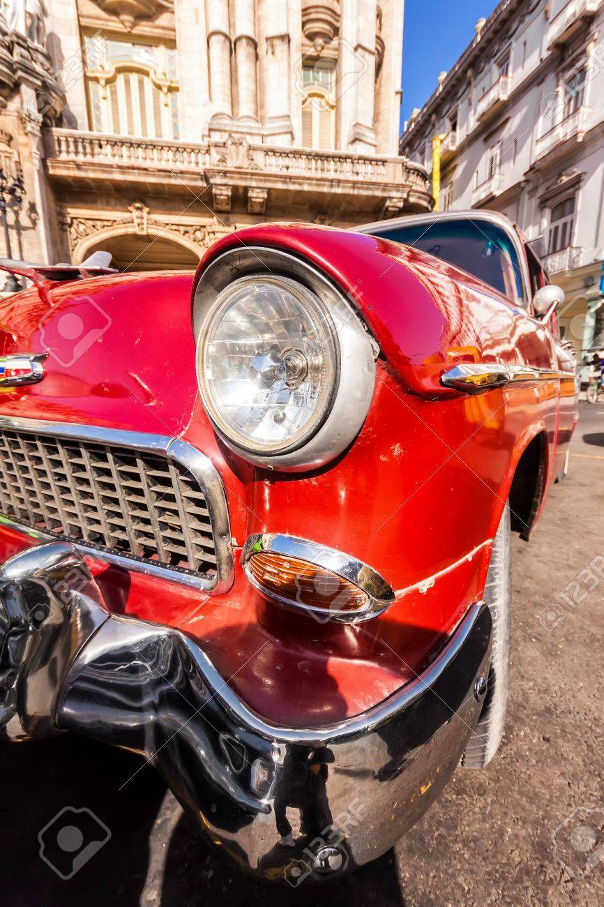 Red classic car near The Great Theater in Havana Stock Photo - 14820552