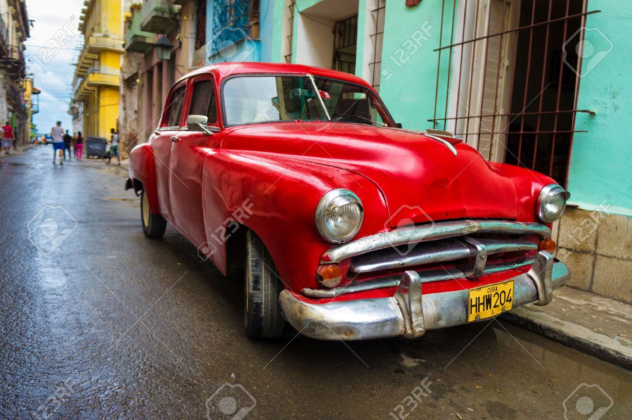 Old Classic Car In A Shabby Neighborhood In Havana Thousands.. Stock ...