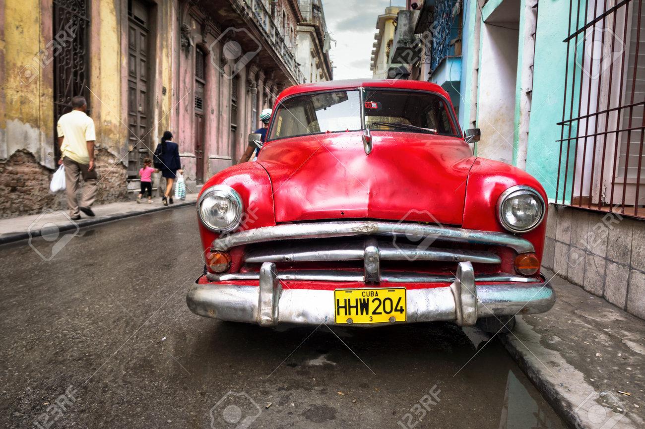 Old Classic Car In A Shabby Neighborhood In Havana Thousands