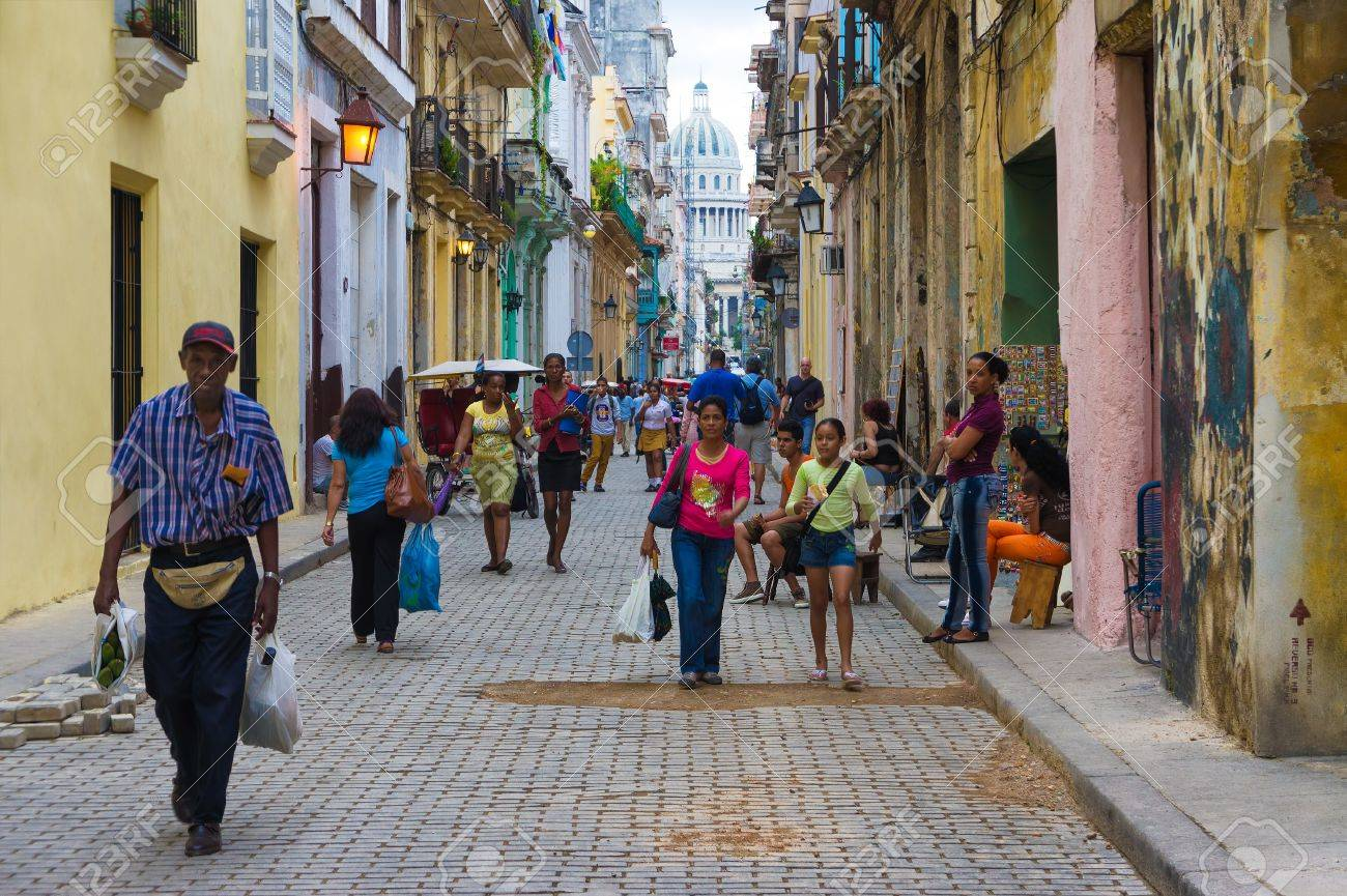 Street in the old neighborhood with the Capitol in the distance  in Havana Founded in 1515,Havana is the largest city in the Caribbean with 2 4 million inhabitants Stock Photo - 16605971