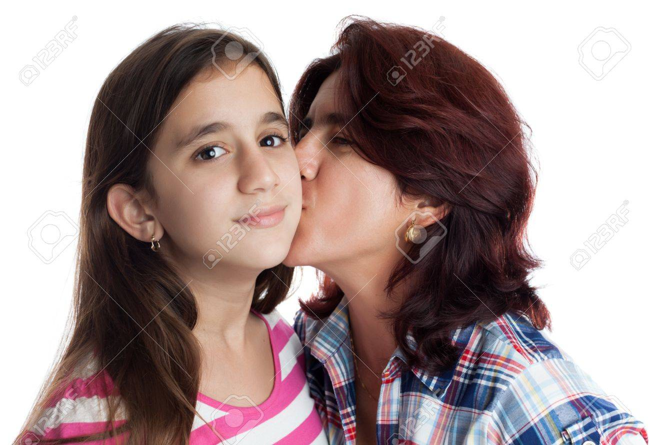 Hispanic mother kissing her beautiful daughter isolated on white Stock Photo - 17251723