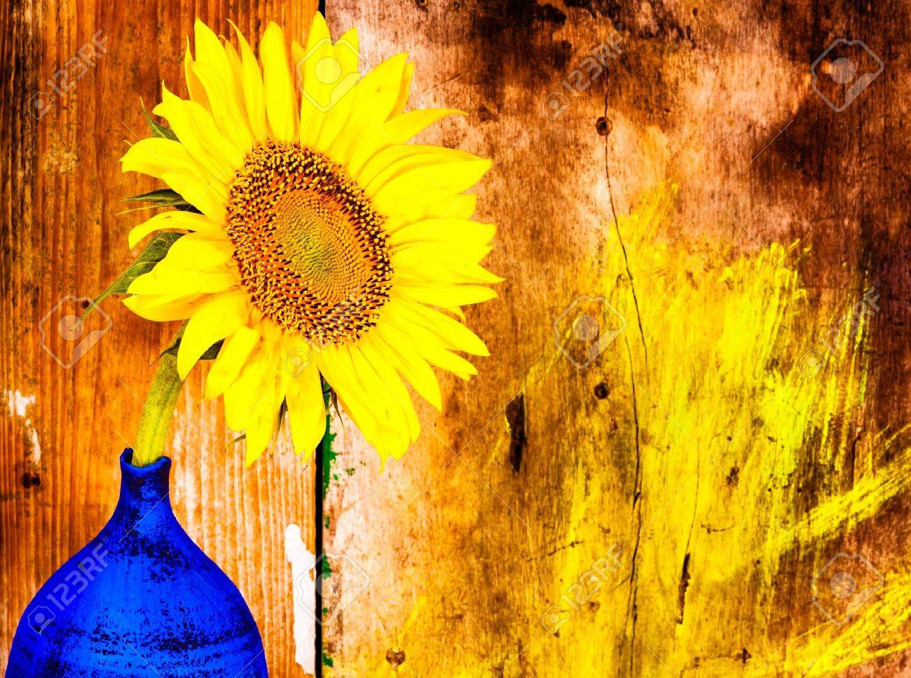 Sunflower On A Blue Vase With Grunge Rustic Wooden Background