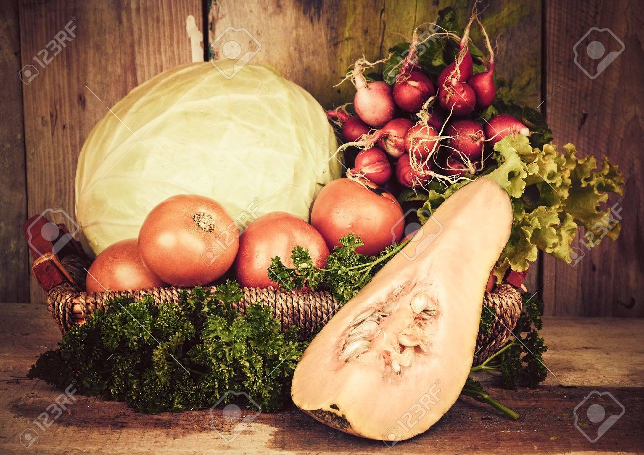 Vintage image of fruits and vegetables on a basket with a rustic background Stock Photo - 18558896