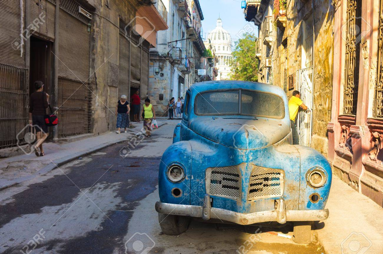 Street Scene With An Old Rusty American Car In Havana These.. Stock ...