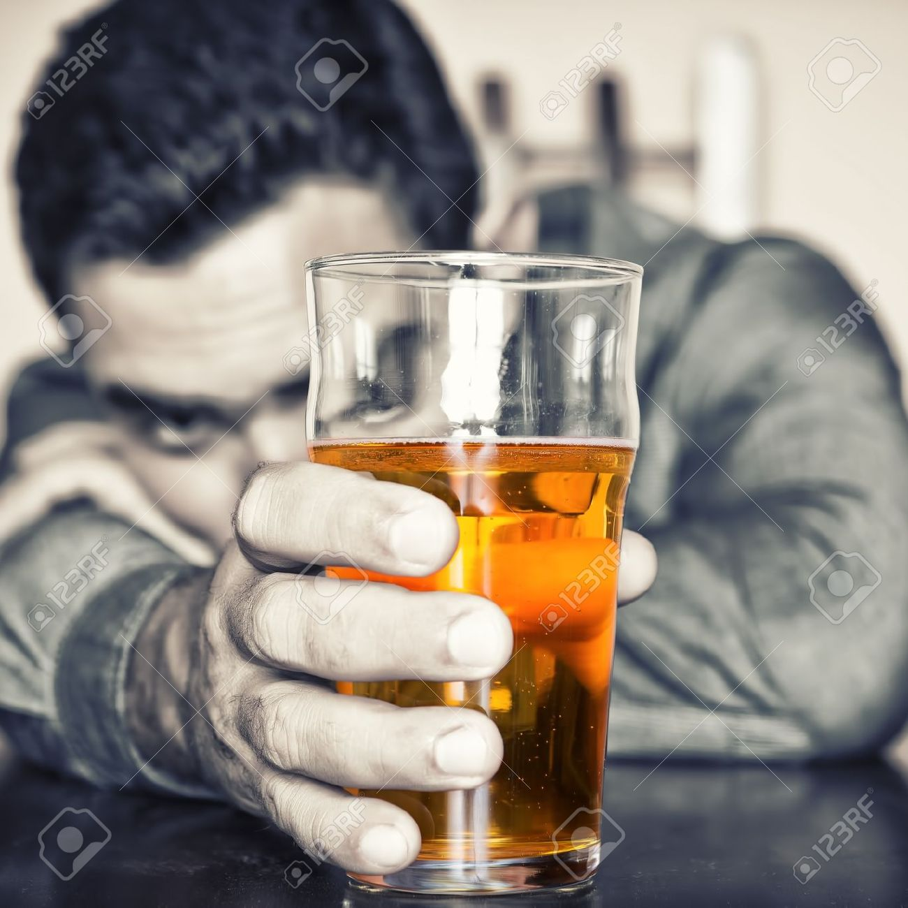 Grune image of a drunk man holding a glass of beer Stock Photo - 20330630