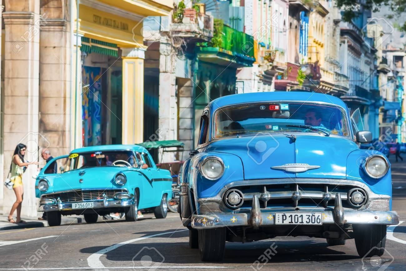 Old Classic Cars Used A Taxis Circulating On A Well Known Street ...