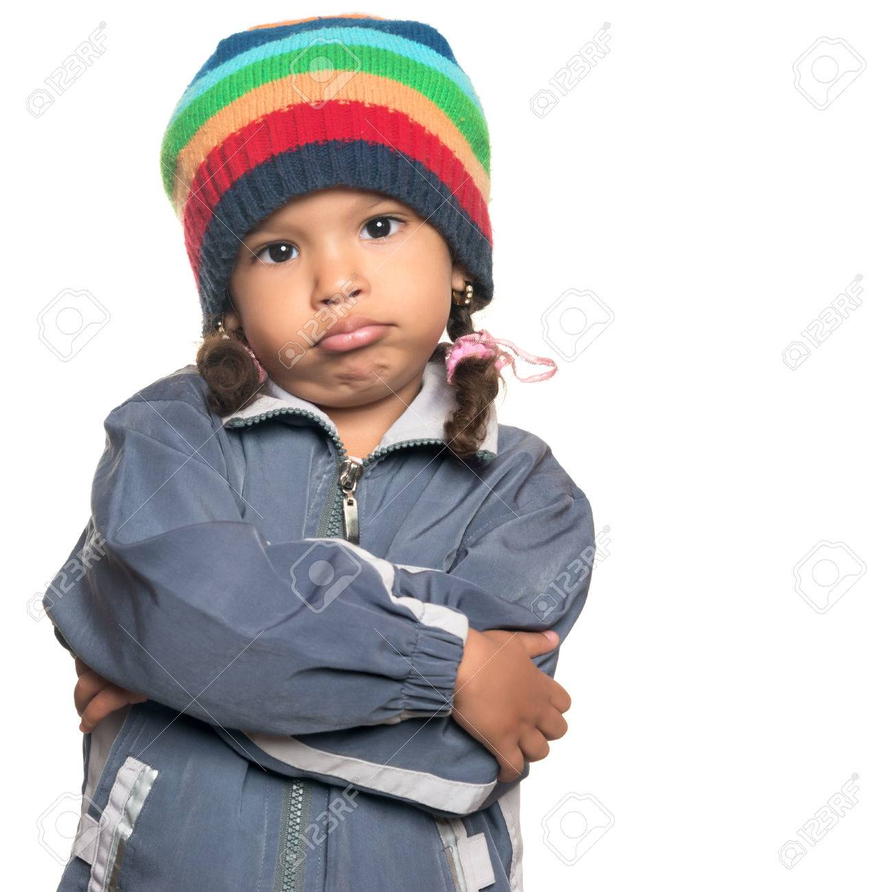 Funny Mixed Race Little Girl Wearing A Colorful Beanie Hat And A Jacket With A Rapper