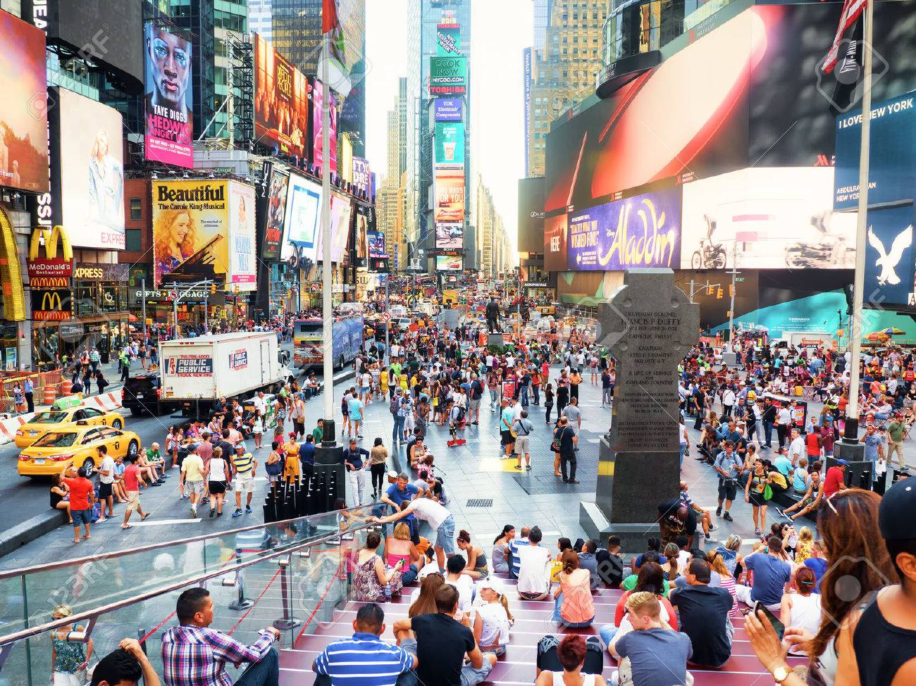 Tourists and colorful neon billboards at Times Square in New York City - 45927082