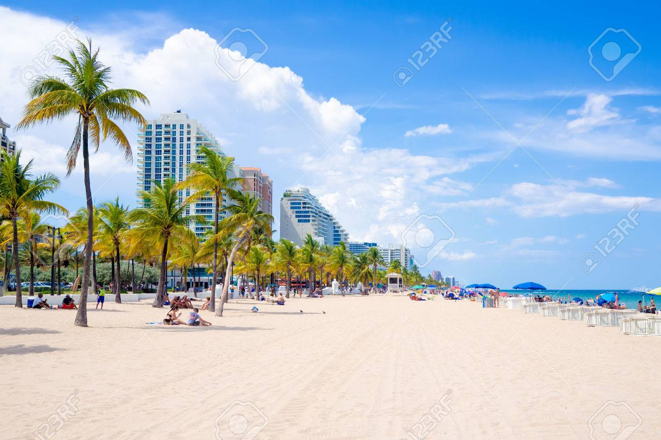 people enjoying the beach at fort lauderdale in florida on a stock