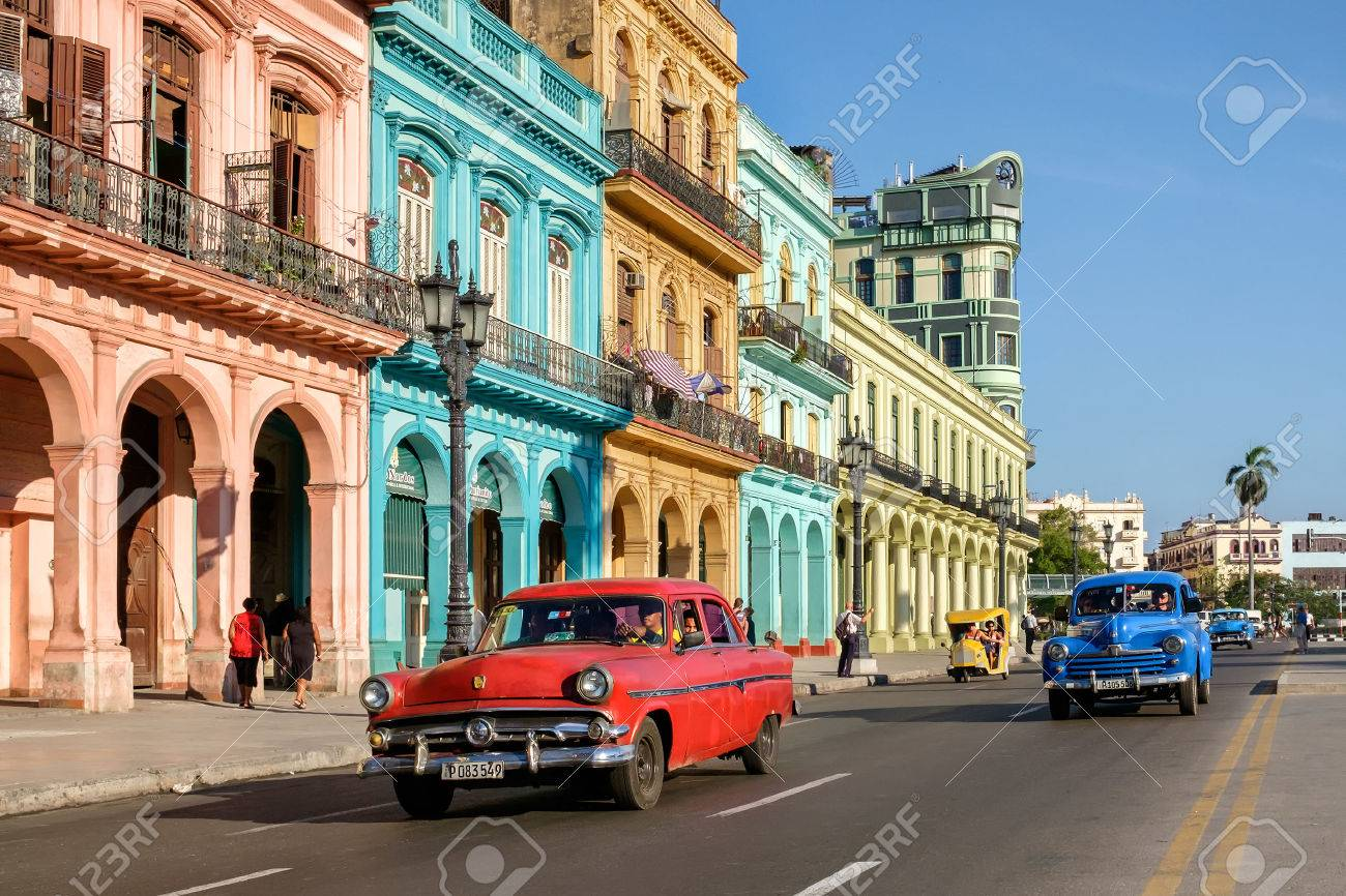Street scene with colorful buildings and old american car in downtown Havana - 59196853