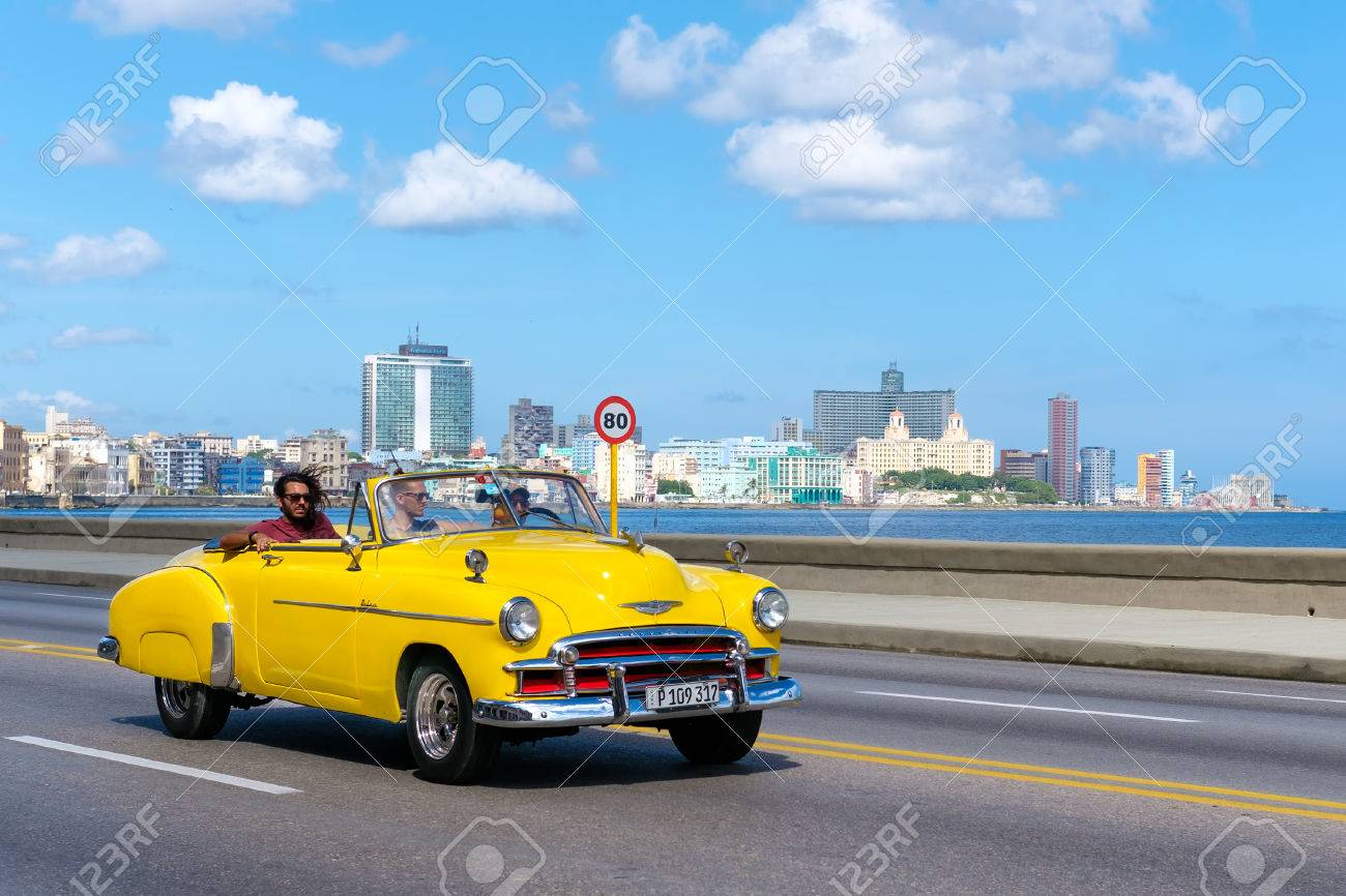 Old Convertible Car On The Havana Malecon Avenue With A View.. Stock ...