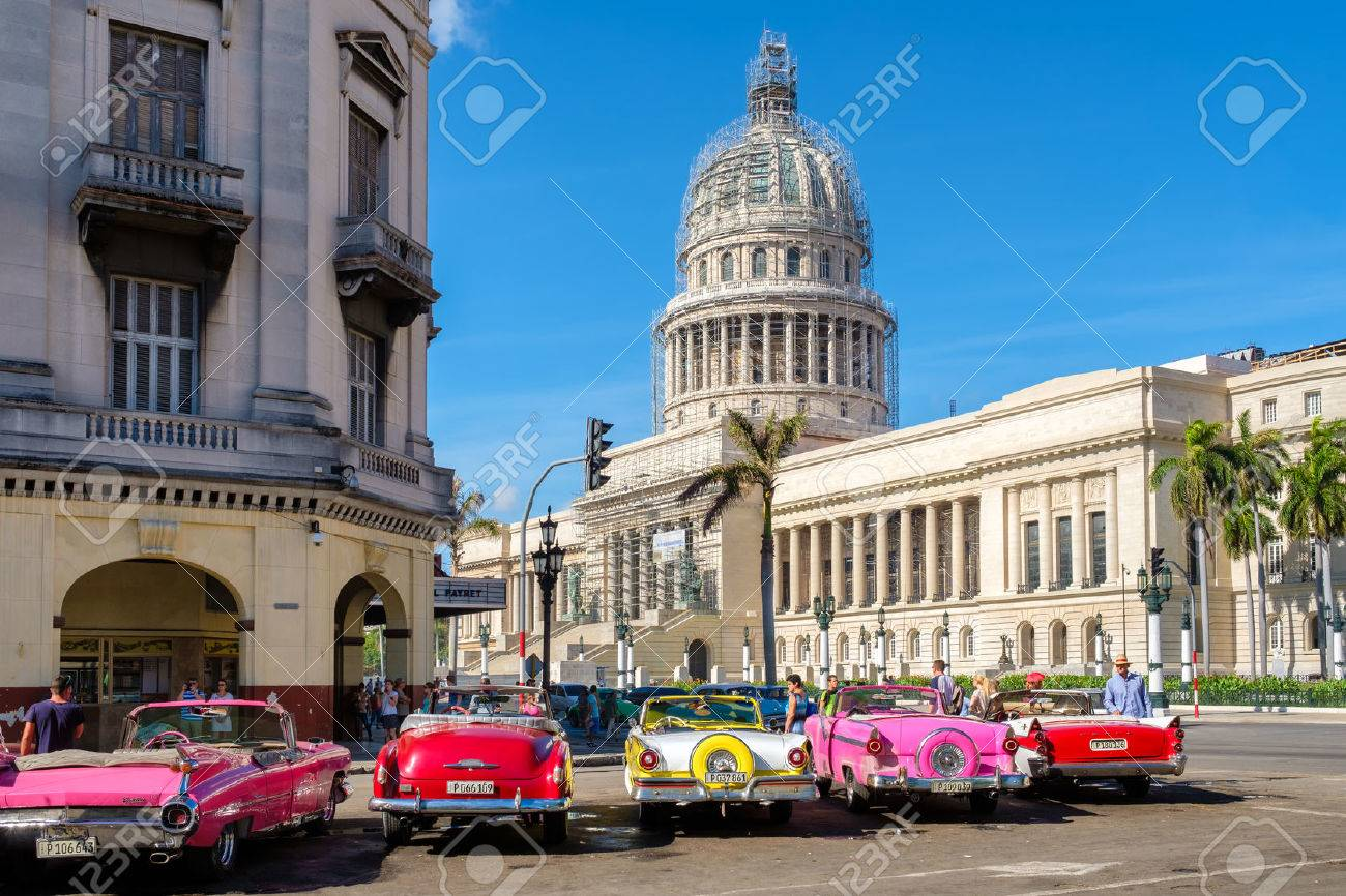 Group Of Colorful Old Classic Cars Near The Capitol In Old Havana ...