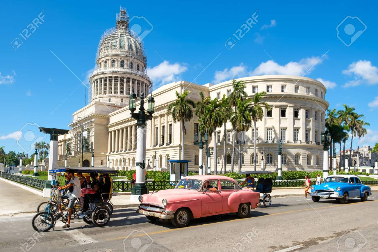 Street scene with classic cars near the Capitol in downtown Havana - 59428514