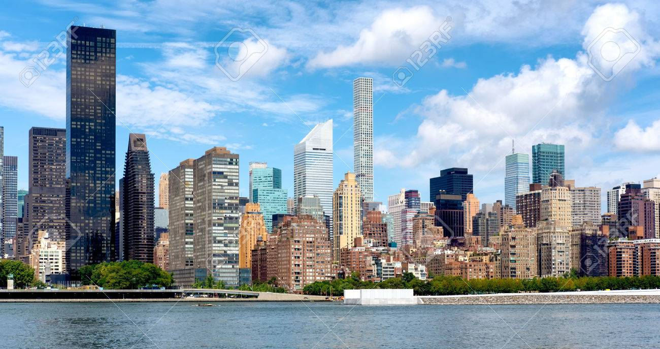 Old Apartment Buildings And Modern Skyscrapers In Midtown Manhattan, New  York City Stock Photo
