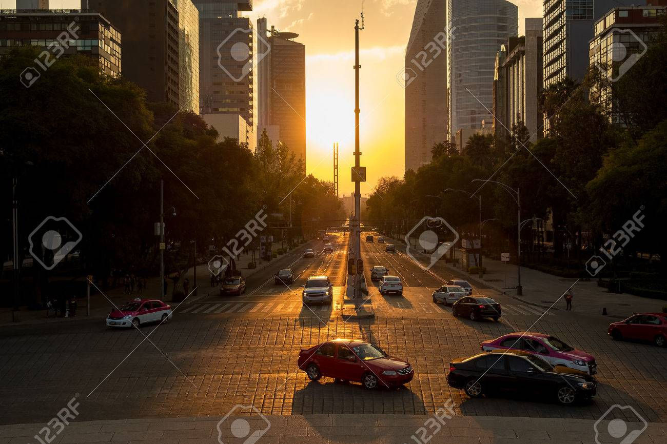Sunset in Mexico City with a view of traffic and buildings at Paseo de la Reforma - 69331898