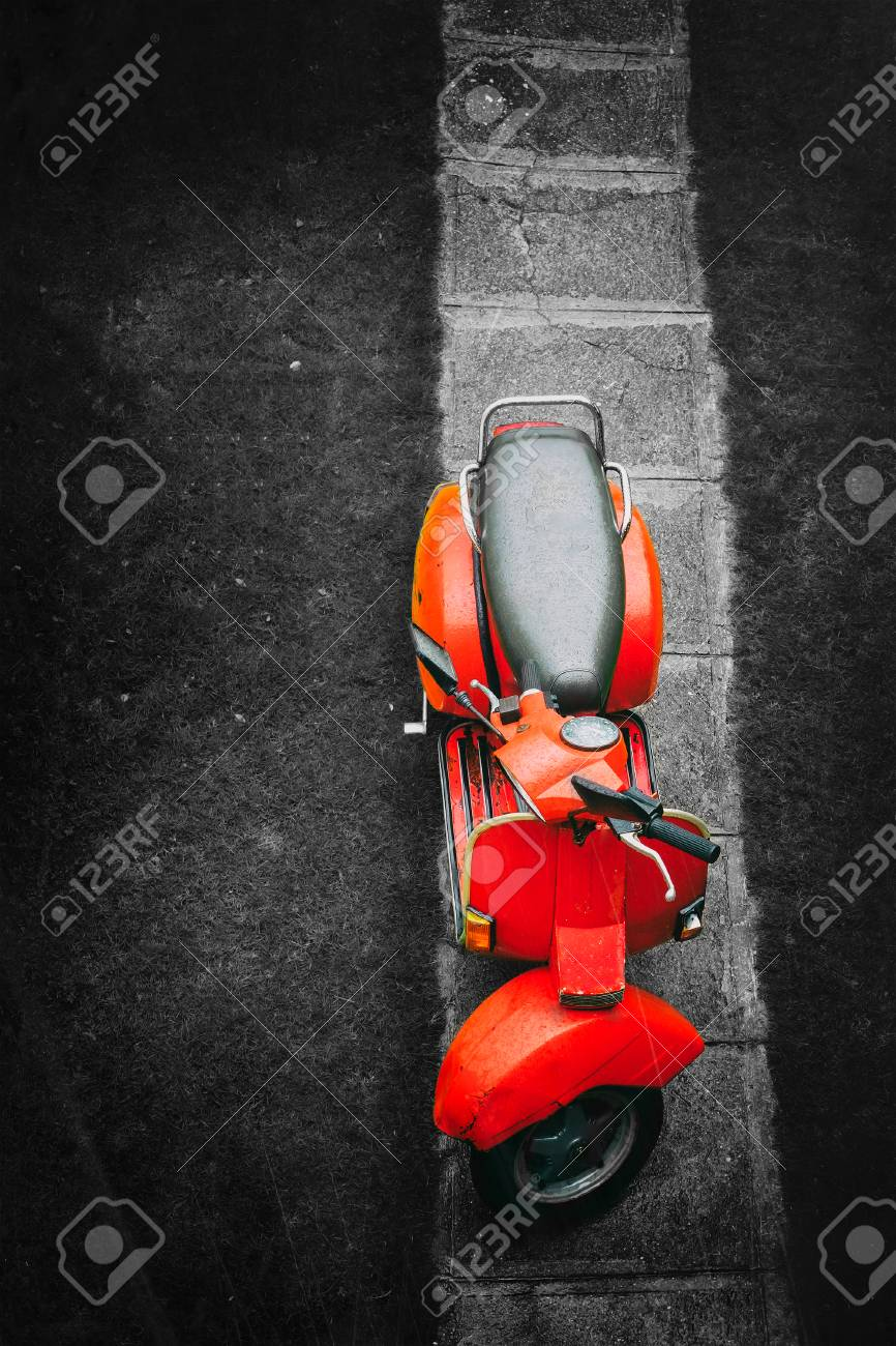 Red vintage italian scooter on a black and white background - 80696311