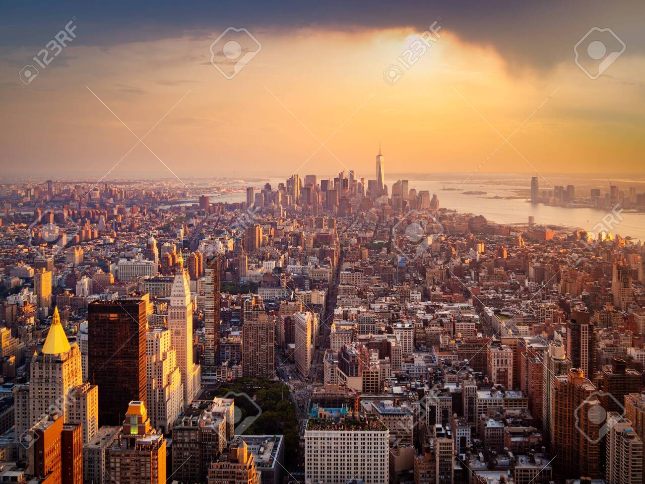 Aerial view of New York City illuminated by the rising sun - 146350920